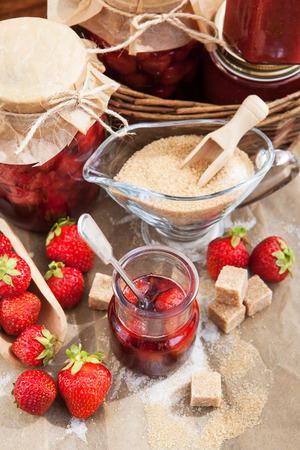 Homemade strawberry jam in a glass jar photo