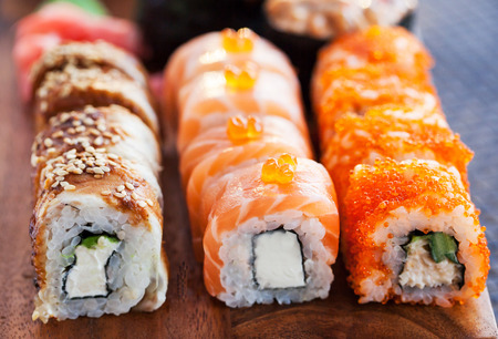 Assorted of fresh homemade sushi rolls on the table