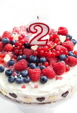 Birthday homemade creamy cake decorated with fresh berries and number two photo