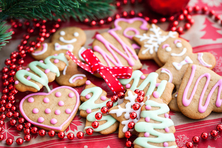 Christmas homemade gingerbread cookies on festive background photo