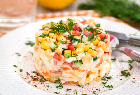crab: Fresh vegetable salad with corn, pepper, crab, cucumber, eggs and mayonnaise