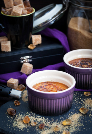 gas burner: Creme brulee with gas burner caramelized, dark style photo