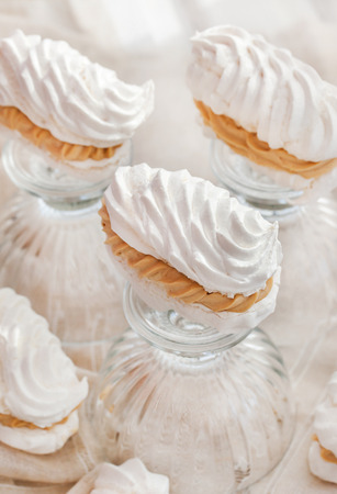 kiss biscuits: Fresh delicious meringue and caramel butter cream cake Stock Photo