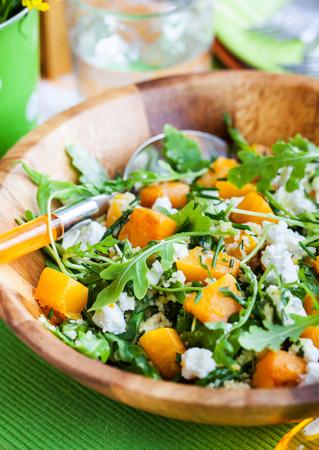 eating salad: Delicious butternut squash, arugula, couscous and feta salad Stock Photo