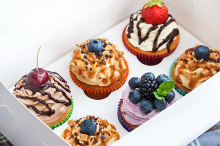 birthday cupcake: Set of different delicious cupcakes in a paper box
