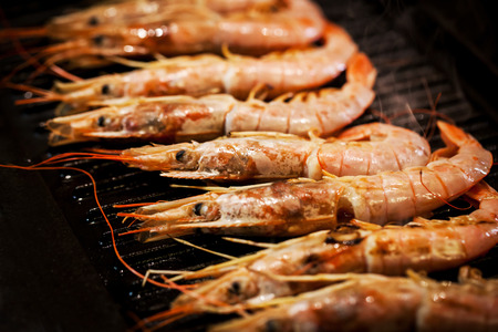langoustine: Delicious langoustines cooking on grill