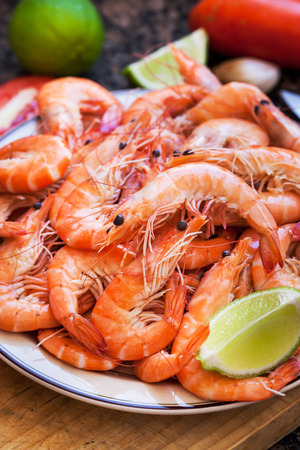 langoustine: Fresh delicious prawns with lime on the plate