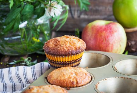 mini oven: Fresh homemade delicious apple muffins for breakfast Stock Photo