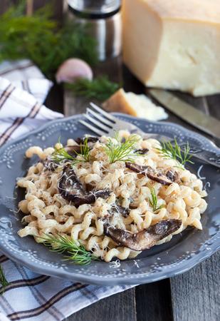 porcini: Spaghetti pasta with porcini and parmesan cheese Stock Photo