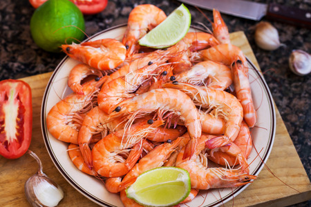Fresh delicious prawns with lime on the plate