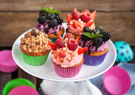 bramble: Set of different delicious cupcakes on funny cake-stand