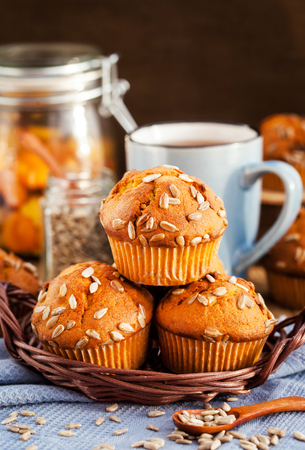 mini oven: Fresh homemade delicious pumpkin muffins with sunflower seeds for breakfast