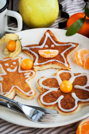 bear berry: Kid`s breakfast - funny pancakes in the shape of bear, flower and star