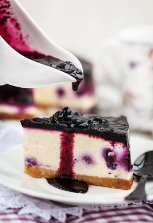 a portion: Portion of delicious blueberry cheesecake Stock Photo