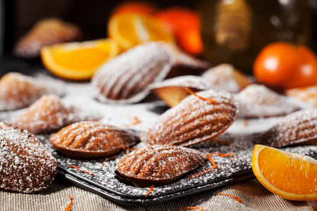 confectionery: Fresh homemade orange and honey madeleines cookies