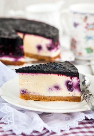 portion: Portion of delicious blueberry cheesecake Stock Photo