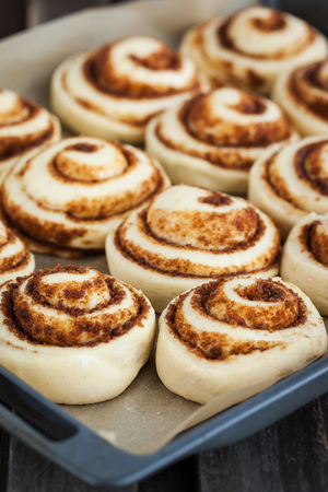 christmas baker's: Raw cinnamon rolls. Preparation process - unbaked dough, waiting befor baking