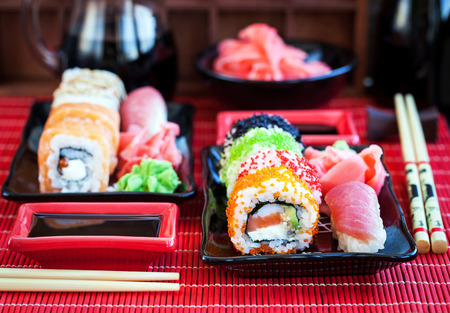 Assorted of fresh delicious sushi and rolls on table, japanese food