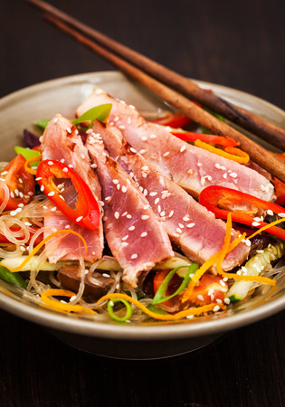 asian flavors: Delicious grilled tuna and  asian rice glass noodles with vegetables