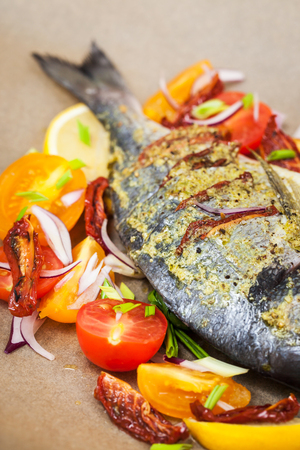 gilthead bream: Raw whole sea bream fish and vegetables ingredients, ready to cook Stock Photo