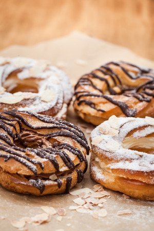 Chocolate and powdered sugar cream puff rings (choux pastry), black and white