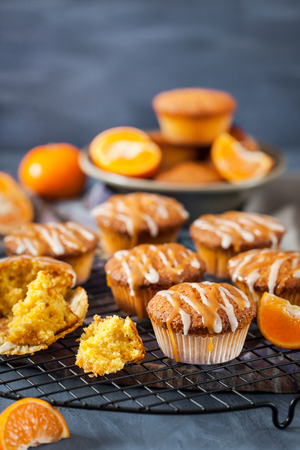Carrot tangerine cupcakes decorated with glaze and caramel topping