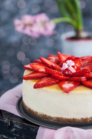 Delicious cheesecake decorated with fresh strawberries