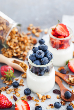 Delicious plain yogurt with fresh blueberry and strawberry in a glass jars for breakfast Stock Photo