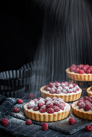 Delicious raspberry mini tarts (tartlets) with whipped cream on dark background Stock Photo