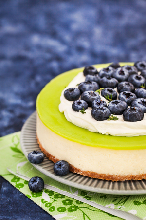 Delicious key lime cheesecake decorated with fresh blueberries Stock Photo