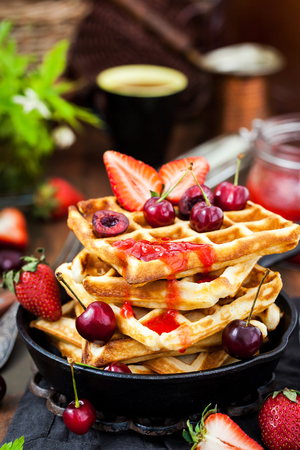 Belgian waffles with fresh berries and jam for breakfast Stock fotó