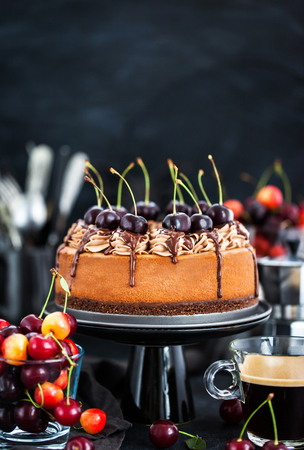 Delicious homemade chocolate cheesecake decorated with fresh cherries Stock Photo
