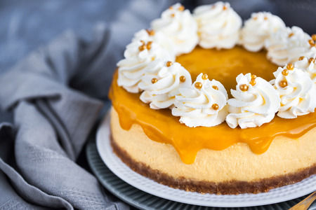 Delicious mango cheesecake decorated with whipped cream  Stock Photo
