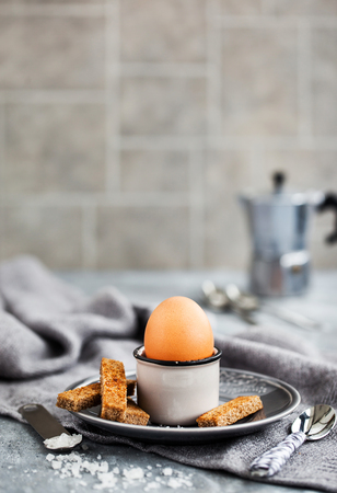 Boiled egg with rye toasts for breakfast Stock Photo