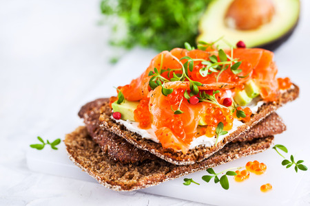 Salted salmon, red caviar, avocado and cream cheese rye crisp toast