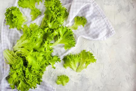 Fresh raw green frillice iceberg lettuce salad on table, top view Banco de Imagens - 122325886