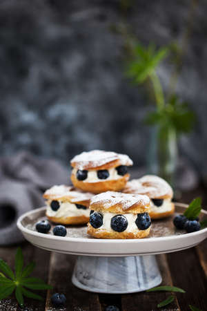 Cream puff rings (choux pastry) decorated with fresh blueberries