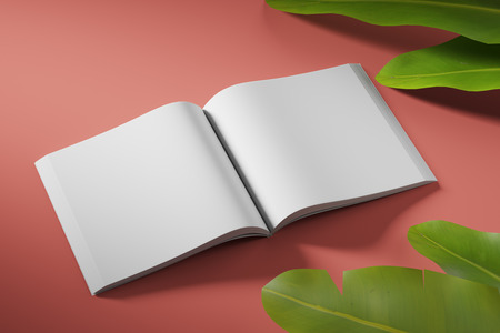An empty book unfolded on a red background with tropical flowers. Mock up.