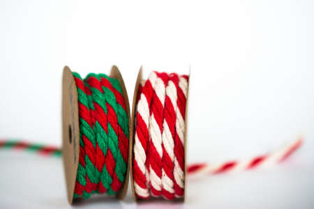 Red  White and Red  Green Twine Ribbons on white background Stock Photo