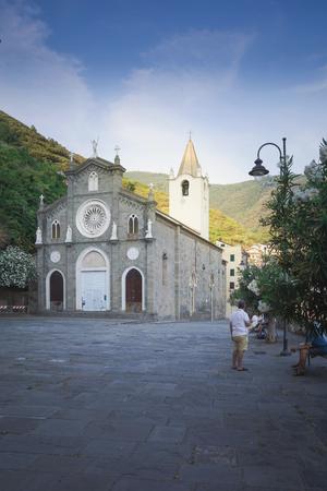 Church of San Giovanni Battista in Riomaggiore, Cinque Terre, Italy, 06 august 2018: Square in front of the Church of St. Giovanni Battista