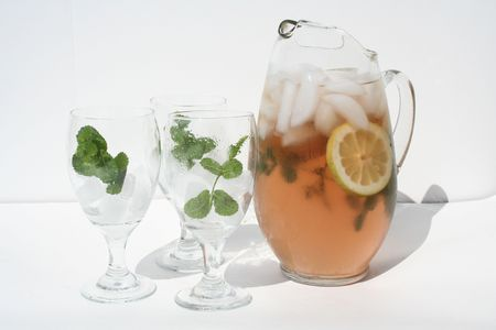 Pitcher of ice tea with three glasses Stock Photo