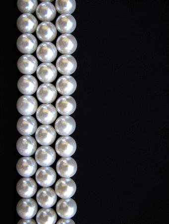 Pearls on black background