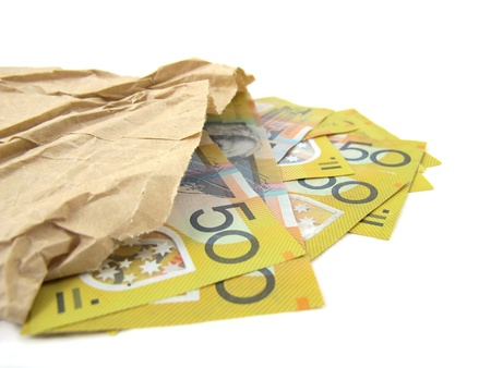 Australian Fifty Dollar notes in paper bag Stock Photo