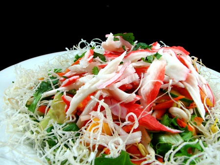 crab meat: Seafood Salad with crispy noodles Stock Photo