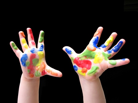 Toddlers hands with paint