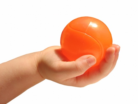 two year old: Two year old holding orange ball