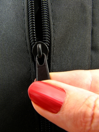 undressing woman: Opening zipper