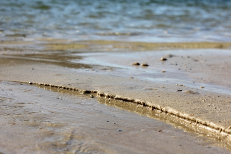 meanders: Macro Sand and Waters edge background Stock Photo