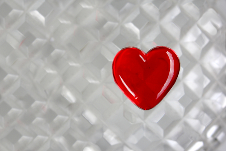 crystal glass: Red Glass Heart on Cut Crystal Background