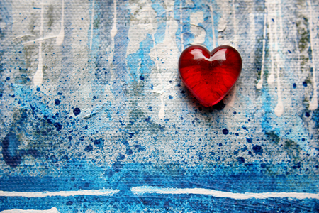 fourteenth: Red Glass Heart on Blue Painted Background